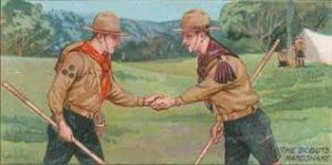Scout left hand shake